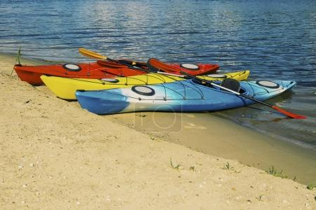 Photo for Kayaking on the Lake Concept Photo. Sport Kayak on the Rocky Lake Shore. Close Up Photo. - Royalty Free Image