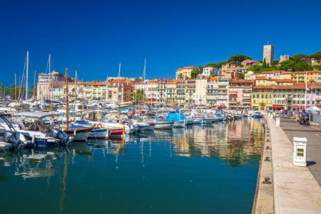 Harbor in Cannes city with colorful houses and promenade on French riviera