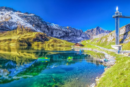 Crystal clear Melchsee and Swiss Alps panorama from Melchsee Frutt