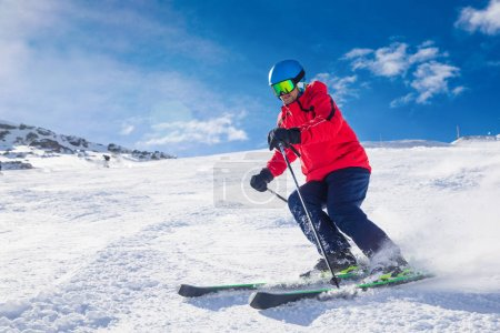Man skiing on the prepared slope with fresh new powder snow in Tyrolian Alps, Zillertal, Austri