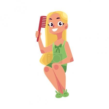 Petite fille en chemise de nuit et pantoufles peignage longs, cheveux clairs