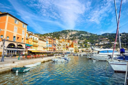 View of colorful houses on seafront in village of Villefranche-sur-Mer. Cote d'Azur, France