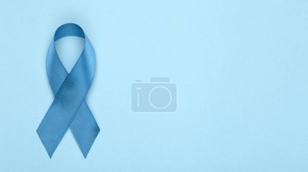 Blue ribbon on background. Prostate cancer awareness month. Blue ribbon symbol of world prostate cancer month and concept of healhcare. Copy space.