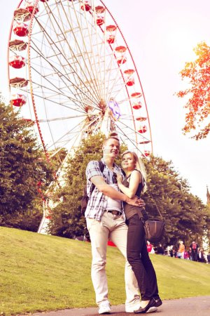 Young couple have good time in summer park