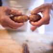 Hands of unrecognizable man making sausages the tr...