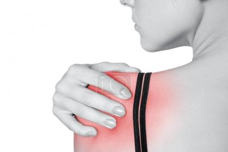 young woman with pain on her arm and shoulder. isolated on white background. Black and white photo with red dot
