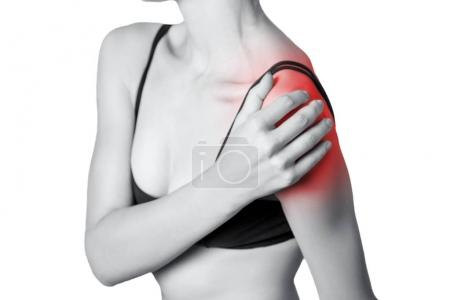 young woman with pain on her arm and shoulder.  isolated on white background. Black and white photo with red dot.