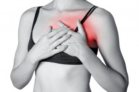 young woman with holding chest, pain on heart.  isolated on white background. Black and white photo with red dot.