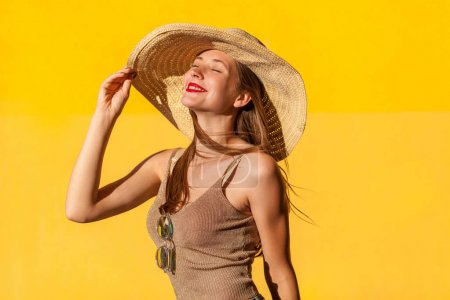 Fashionable young adult model looking up and closed eyes