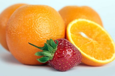 Orange, strawberries on white background