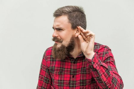 I can not hear you. Young adult bearded man listen