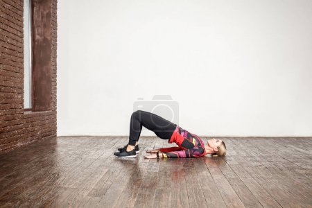 lady doing aerobic exercise on wooden floor, weight loss concept