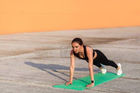 Beautiful fit brunette woman in tight sportswear, ...