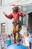 Colorful medieval jester of period on acrobatic ball