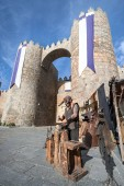 Steel craftsman working alongside the wall of Avila in the foreg