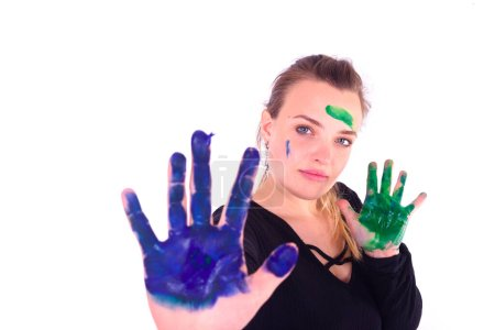 Photo for Painter girl paint in the front of camera in the white background - Royalty Free Image