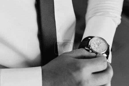 Photo for Businessman checking time on his wrist watch - Royalty Free Image