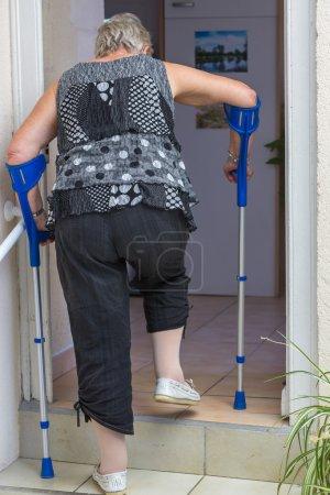 Senior woman with crutches
