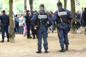 Paris, France - july 14, 2014: French police patrol (CRS) assigned to the surveillance. These troops ensure the security of the citizens during the parade of July 14 at the entrance of the avenue des