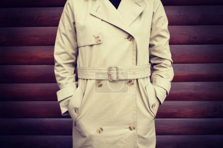 woman in stylish beige coat