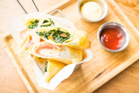 Fried spring roll with ham cheese