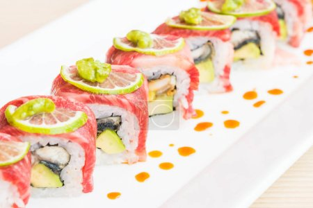 Beef sushi in white plate