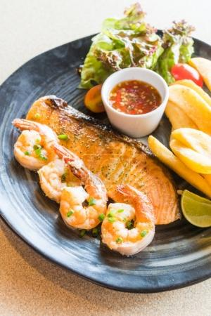 Grilled salmon and prawn steak