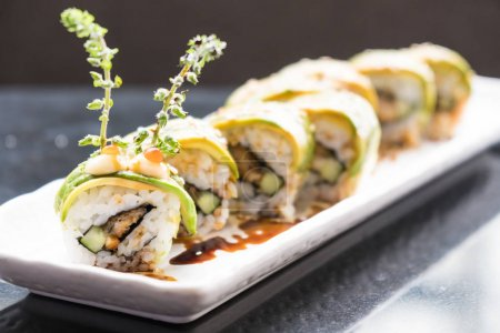 Avocado sushi in white plate