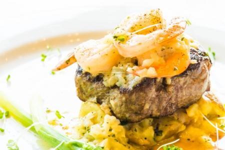 Grilled beef and shrimp or prawn steak