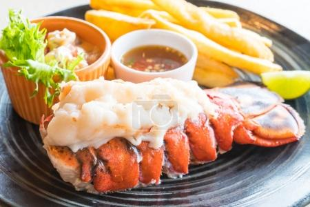 Lobster steak in black plate