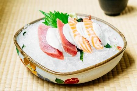 Raw and fresh sashimi set with salmon and tuna fish meat and cheese - Japanese food style