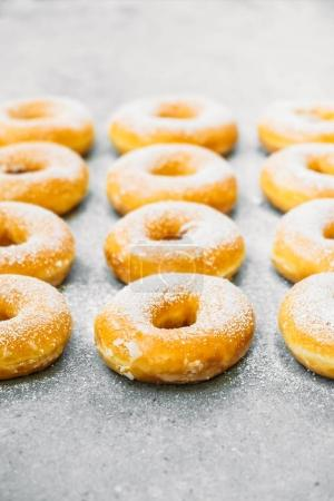 Sweet dessert with many donut on top with sugar icing - Unhealthy food style
