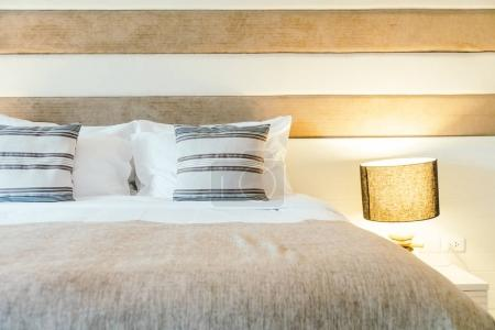 Pillow on bed decoration in bedroom interior with light lamp - Filter Processing