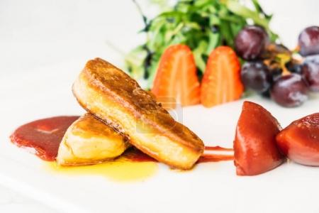 Foie gras with vegetable and fruit in white plate