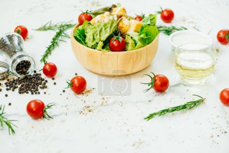 Clean and healthy food style with Caesar salad in wooden bowl