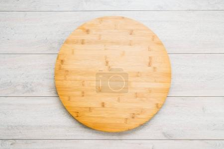 Wood cutting board on wooden background with copy space
