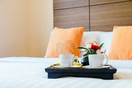Coffee for breakfast on bed decoration in bedroom interior