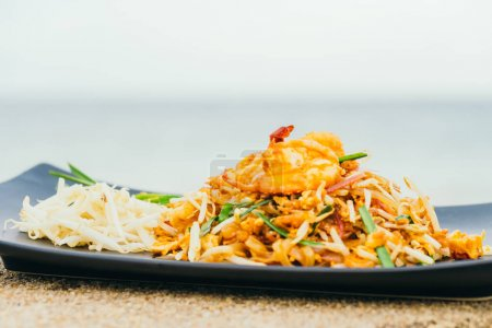 Stir fried noodles with prawn and shrimp in plate or Pad Thai