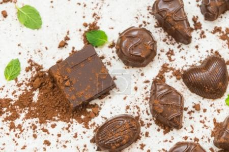 Photo for Sweet dessert with dark chocolate pieces and cocoa powder on white stone background - Royalty Free Image