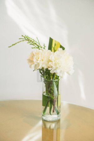 Vase with white flower on table decoration interior of room
