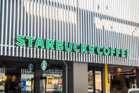 PATTAYA , THAILAND Jan 20 2018 Starbucks sign and store around m