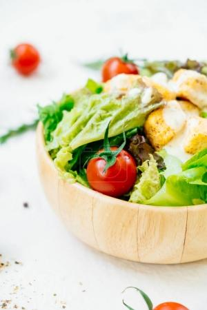 Photo for Clean and healthy food style with Caesar salad in wooden bowl - Royalty Free Image