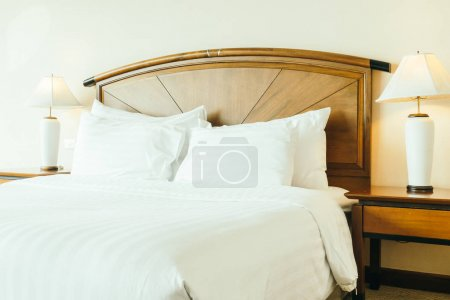 Photo for White comfortable pillow on bed decoration in hotel bedroom interior - Royalty Free Image