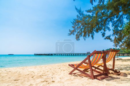 Photo for Empty chair on the beach and sea in beautiful island - Holiday Vacation concept - Royalty Free Image