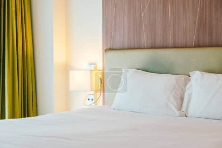 Photo for White pillow on the bed decoration in bedroom interior - Royalty Free Image