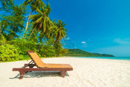 Beautiful nature tropical beach and sea with chair and coconut p