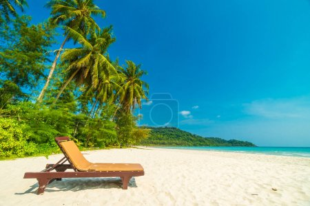 Photo for Beautiful nature tropical beach and sea with chair and coconut palm tree on paradise island for travel vacation - Royalty Free Image