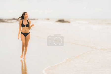Photo for Portrait beautiful young asian woman wear bikini on the beach sea ocean for leisure relax in holiday vacatiom time - Royalty Free Image