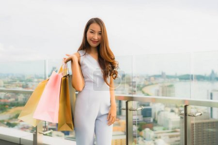 Photo for Portrait beautiful young asian woman happy and smile with shopping bag from department store mall - Royalty Free Image