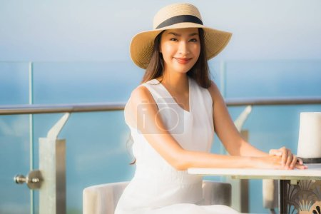Photo for Portrait beautiful young asian woman smile happy in the sky bar and restaurant for relax and enjoy food - Royalty Free Image